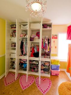 Cubby-Style Closet in Creative Shared Bedroom for Three Girls from HGTV