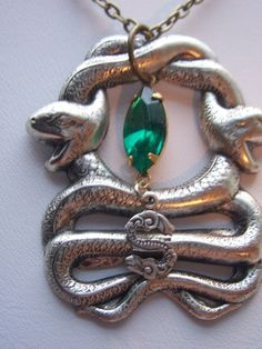 I am Slytherin  - Slytherin emerald  crest  necklace. $23.00, via Etsy.