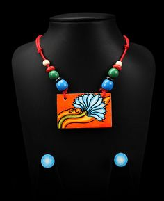 Hand painted Kerala Mural Bamboo pendant with tassels made of wood, metal and stones strung together with colorful threads.