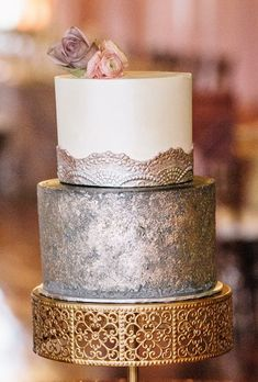 A two-tiered wedding cake with a silver bottom layer and antique silver accents, from The Cake Hag.