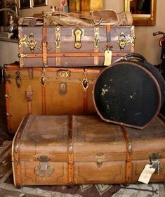 Vintage leather suitcases...i love decorating with these.