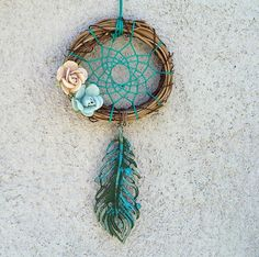 This dream catcher was made with a tiny wreath handwoven with vibrant teal blue thread and decorated with two paper flowers and a brass painted feather charm. Los Dreamcatchers, Feather Painting, Mobiles, Ideas Geniales, Dream Decor, Suncatchers, Wind Chimes, Hand Weaving, My Etsy Shop