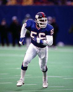 Giants #56 - Lawrence Taylor Famous Baseball Players, Nfl Football Players, Steelers Football, Sport Football, Football Helmets, School Football, New York Giants Football, Phil Simms, Lawrence Taylor