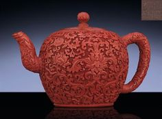 A VERY RARE CINNABAR LACQUERED YIXING TEAPOT QIANLONG INCISED SIX-CHARACTER SEALMARK AND OF THE PERIOD (1736-1795)