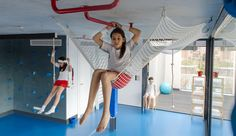 This company has an interesting asethetic with children spaces - blue gym indoor climbing