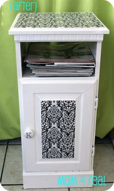 I washed it down, sanded it, and painted it white.  I didn't bother with pics of those steps, because they are pretty boring.  After prepping the cabinet, I picked out some pretty black and white paper.  Huh?  Paper, you ask?  Yep, we are going to Mod Podge this baby!