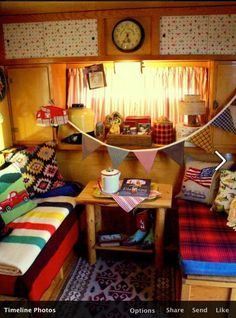 vintage camp theme - I like how they removed the big table and put a smaller, coffee-table type piece of furniture in its place.