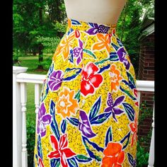 "vintage yellow orange purple floral pleated skirt super cute vintage orange yellow purple floral flower power long pleated cotton skirt;  side hook closure; label Intentions; marked size 16; measurements waist 32""; length 34""; material 100% rayon; great condition Vintage Skirts"