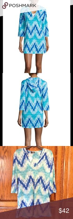 "Blue and Green Long Sleeved Beach Cover Up This ultra soft beach cover up gives off a beachy vibe. Hooded. Cool tie dye chevron print in blue and green. V neck, 3/4 sleeves. Approx. 32.5"" in length. Polyester. Hand wash, dry flat. Available in medium and extra large. M(8/10) fits bust 35 1/2""-36 1/2"", waist 27 1/2""-28 1/2"", hips 38""-39"". XL(16/18) fits bust 40 1/2""-43"", waist 32 1/2""-35"", hips 43""-45 1/2"". Swim Coverups"
