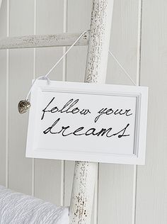 "white hanging sign ""follow your dreams"""