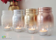 These beautiful and elegant mason jars are capped with metallic colors or white. - Marushis Home Decor These beautiful and elegant mason jars are capped with metallic colors or white. They are painted on the outside only, so are ideal for tea light Mason Jar Candle Holders, Mason Jar Centerpieces, Mason Jar Candles, Painted Mason Jars, Centerpiece Decorations, Mason Jar Crafts, Diy Candles, Mason Jar Diy, Christmas Decorations