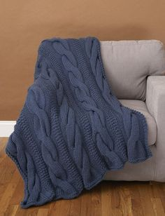 Free knitting pattern for Cable Comfort Throw - afghan with chunky cables. Size 48 x 48 in. [122 x 122 cm] Knit in super bulky yarn. affiliate link tba