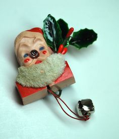 Vintage Santa Pin with Light UP Nose. That last week before Christmas, when you can hardly wait anymore and you're just sure you'll be bad before Satnta makes it, my Mom would buy me one of these to pin on my coat!!  LOVE HIM!  He's the magic that gets you over the hurdle that very last week! ❤