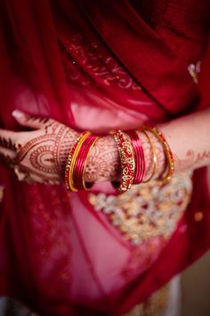 Red Indian wedding idea - red and gold saree with bangle bracelets + henna {Morgan Lindsay Photography}