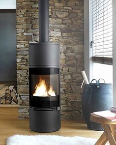 The Alcor wood burning fireplace is sleek, elegant and fuel efficient. With panoramic curved glass and strong cast iron body, it fits easily into compact spaces Cast Iron Fireplace, Fireplace Hearth, Stove Fireplace, Modern Fireplace, Fireplace Design, Fireplaces, Pellet Stove, Buck Stove, Home Decor Catalogs