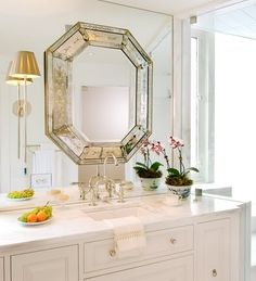I definitely want to do this in my master bathroom: venetian mirror on the mirrored wall.