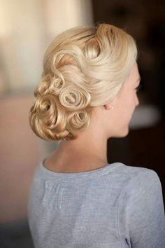 Vintage Styled Wedding Updo.  lots of good looks on this whole website though