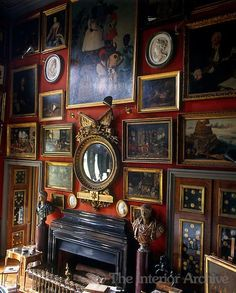 wall of the double-height drawing room is covered in a collection of framed artwork ~ Chateau de Groussay English Interior, English Country Decor, Framed Artwork, Wall Art, Red Rooms, English Style, English Manor, Drawing Room, Beautiful Interiors