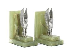 A PAIR OF ART DECO SILVER AND ONYX BOOK ENDS by Boodle & Dunthorne, London 1934 Sold for US$ 1,420 inc. premium DECORATIVE ART AND DESIGN 12 Apr 2018