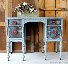 distressed dresser red knobs
