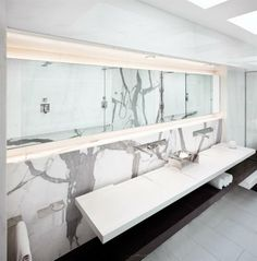 long frameless mirror give more spacious look to the bathroom