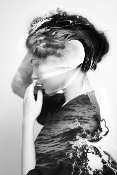 Double Exposure. White background blocks out other texture, overwhelming black of water allows the woman to appear. Boom. Challenge accepted.