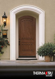 Therma-Tru Classic-Craft Rustic Collection fiberglass door with clavos.