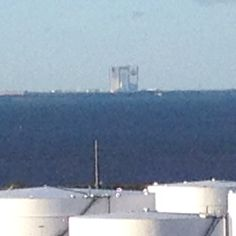 The Vehicle Assembly Building at Kennedy Space Center, off in the distance