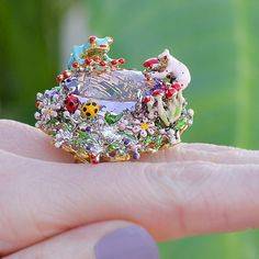 Are ready for spring?! It officially arrives later this afternoon 4:45 MT. Spring has brought out the colorful #enamel frogs over the pond ring by #Santagostino. #spring