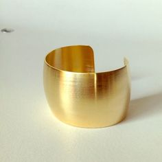 """{PMEP} {HP} Brushed 14k yellow gold cuff bracelet This cuff was shared to every user's feed by @pmeditor 2/18 and selected by @mrsalliexo as a Wardrobe Refresh HP 2/17. This adjustable wide cuff features brushed 14k gold-plated precious metal. Double up with another cuff for an extra punch of drama, Wonder Woman style. No worries about adjustments damaging the band as these babies were made to withstand as many readjustments as needed. Approx. measurements: 2.13"""" W x 1.75"""" D x 1.5"""" H…"""