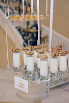 Stunning and creative way to display desserts! Suspend trays with beautiful ribbon! The glass of cold milk is pretty clever too ;)