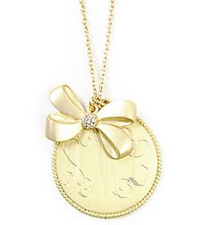 Gold monogrammed necklace and a bow