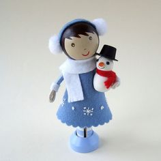 a sweet wee girl and snowman