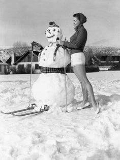 Actress #EstherWilliams offers a skiing snowman a Coke in #SunValley, #Idaho, 1951. | Visitidaho.org