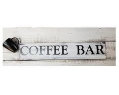 Your very own COFFEE BAR sign! Add warm rustic comfort to your kitchen. Use as decor at a Rustic Wedding or give as a gift.  Sign is approx 27 by 5 1/2 Comes with Saw tooth hanger COLOR CHOICE: GREY WITH WHITE LETTERS, WHITE WITH BLACK LETTERS OR BLACK WITH WHITE LETTERS  This sign will be made to order and no two signs will be exactly the same We use reclaimed vintage wood and hand distress to bring out the natural and unique character of each piece!  Check out the rest of our shop: htt...