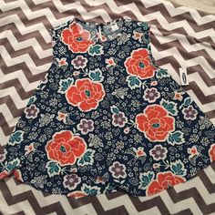 Flower and bird patterned shirt New with tags bird and flower patterned shirt. Size is small. This is a shorter style top- I think it might be petite Old Navy Tops Blouses