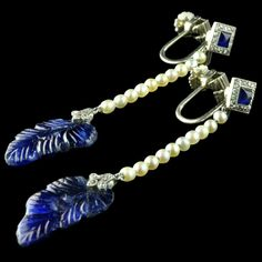 Unsual pair of drop earrings each designed as a row of seed pearls from a diamond and cabochon sapphire surmount suspending a beautifully carved sapphire 'leaf' Art Deco circa 1925