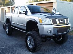 We Offer Fitment Guarantee on Our Rims For Nissan Titan. All Nissan Titan Rims For Sale Ship Free with Fast & Easy Returns, Shop Now. Nissan Titan Lifted, Nissan Titan Truck, 2005 Nissan Titan, Nissan Trucks, Jacked Up Trucks, Big Trucks, Pickup Trucks, Rims For Sale, Wheels For Sale