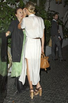 Kate Bosworth - Kate Bosworth at Chateau Marmont. I love the clunky sandals with matching bag.