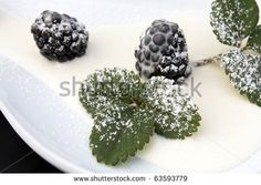 Desserts - Closeup of plate with blackberries, cream and icing sugar.#foodphotos #stockphotos #healthyfood #foodingredients #fruits #ItalianFood #Shutterstock #bio #naturalfood #eatingwell