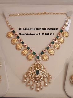 Get the finest designs made with perfect finish. Presenting here is a necklace with Lakshi kasu n Locket Gwt 54 gm Jhumke 15 gm Gwt. Gold necklace with Lakshmi Kasu hangings. Contact no 8125 782 27 November 2018 Gold Jewellery Design, Jewellery Box, Ruby Jewelry, Diamond Jewellery, Jewelry Sets, Gold Jewelry Simple, Jewelry Patterns, Necklace Designs, Indian Jewelry