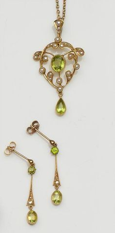 A late Victorian peridot and seed pearl pendant and similar earpendants The 15ct gold openwork pendant with peridot drop below, on bale, to a belcher-link chain, together with a pair of similarly set earpendants