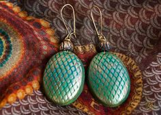 "Ethnic earrings with the effect of the gilding of polymer clay ""Golden pine cones"". Natural motifs."
