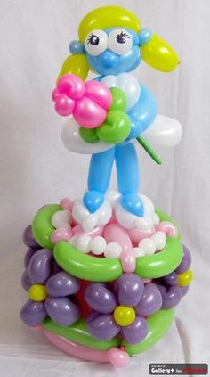 Smurfette on a cake balloon #balloon art #balloon Smurf #balloon Smurfette  #balloon Smurf decor #balloon smurf sculpture #balloon smurf twist #balloon smurf party #balloon smurf characters #balloon papa smurf