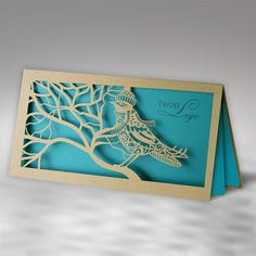 The Christmas card is made of high quality eco brown paper. The eco brown cover has laser cut in a design of bird on the branch. The insert is turquoise and gives the background for the laser cut decorative elements.The envelope is included.