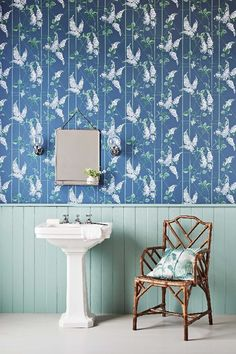 A popular floral wallpaper design from the Cole & Son archive, given a twist with the flowers growing upward across a delicate trellis.