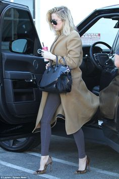 Interview day: Khloe arrived for the shoot in a camel-coloured coat...