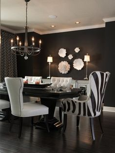 Glam Dining Room - <3 hardwoods, table & chairs! Not so much the black walls.. I'm more of a bright person :))