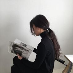 @unconditionalmagazine She reads. And she wears. -Soft wool turtle neck (black) -Mini hoop earrings (silver/small size)