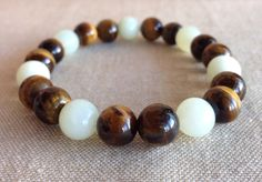 A personal favorite from my Etsy shop https://www.etsy.com/listing/181206564/mensunisex-tigers-eye-and-new-quartzite